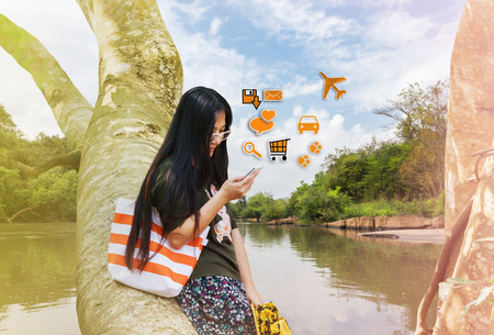 myopia: Myopia women gaze gaze at mobile phone in relax vacation day, concept of addicted to internet or relax in vacation Stock Photo