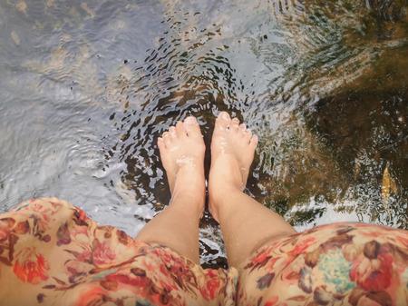 crystalline: Top view of women leg and feet dip in crystalline stream, summer relaxing feeling