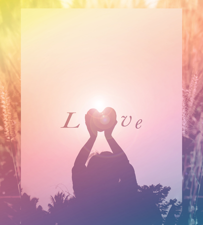 sincere girl: Silhouette back of women raise heart with love and respect to sky on twilight sunlight background Stock Photo