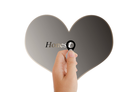 noteworthy: Isolated hand with lens and text honest with heart shape on white background with copy space, concept idea of focus on sincere