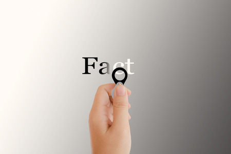 noteworthy: Isolated hand with lens  and text fact on platinum background, concept idea of focus on something