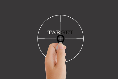 noteworthy: Isolated hand with lens and text target with target sign on grey background with copy space, concept idea of focus on something