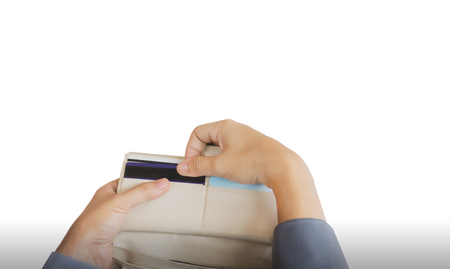 pull out: Hands pull credit card out of wallet