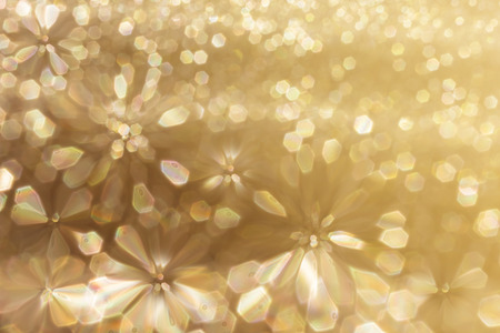 disseminate: Colourful spark and glow colourful shining bokeh light in golden colour tone for abstract background