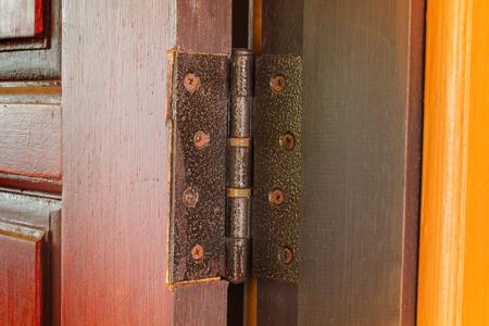 hinge: Steel hinge set up at wooden door Stock Photo