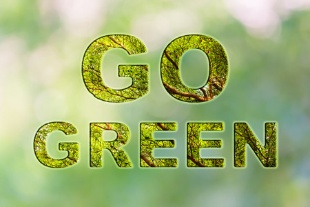 go inside: Text go green with tree bush texture inside font on natural soft bokeh background
