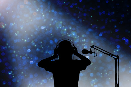 narrator: Silhouette singer women with headphone and microphone, concept voice recording
