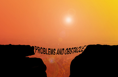 hindrance: Text problems and obstacle silhouette on cliff shadow with blurred highland view background