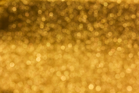 disseminate: Spark and glow shining bokeh light in golden colour tone for abstract luxury background