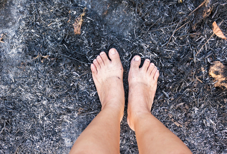 cinders: Barefoot on forest burnt cinders ground, concept world forest protect Stock Photo