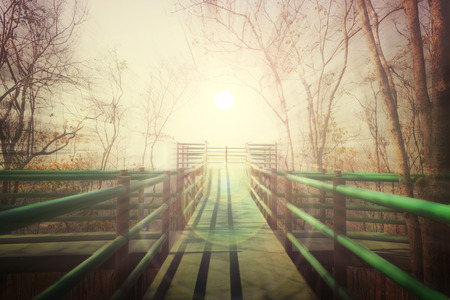 way to freedom: Long footpath or bridge in white fog to light at the end, concept way to peace or freedom, dark to white Stock Photo