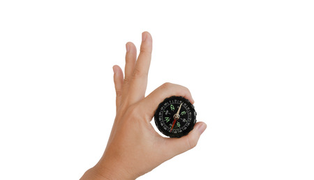 guid: Isolated hand with compass on white background Stock Photo