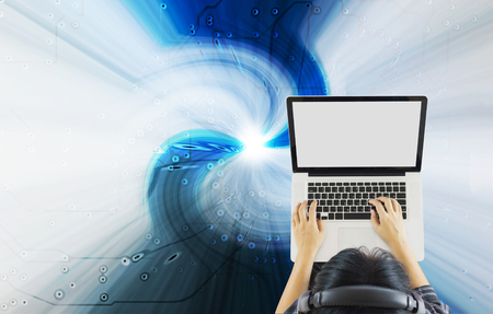 swiftly: Top view girl sitting surfing internet via blank screen notebook on technology modern blue abstract background
