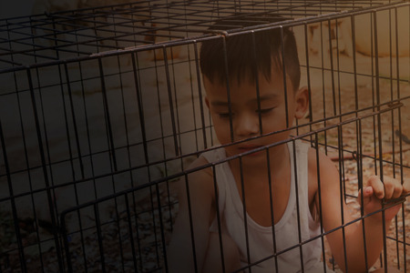 abduct: Boy or kid imprison in cage, kidnap or missing child concept