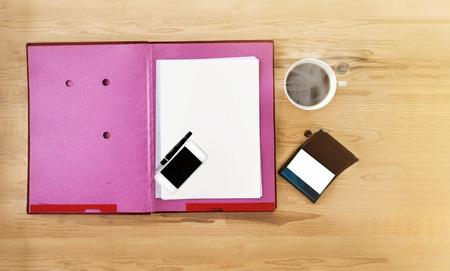 card file: Top view blank paper note on file folder,cellphone,mobile phone, white cup of black coffee ,pen,empty business card on wooden table ans copy space empty area