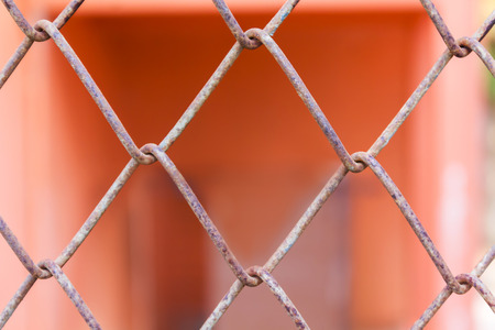 rusty fence: Rusty old balustrade or iron bar pattern on orange colour background, close-up rusty fence