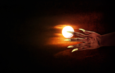 human fingernail: Human hand with long fingernail or devil hand on full moon night with grunge covered for halloween background, horrendous or frightful hand at moon night