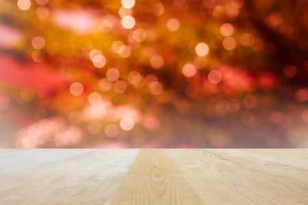 jointed: Blank area or space table top on bokeh light shining and sparkle background, wood table top for putting products on Xmas night golden and romantic pink light background