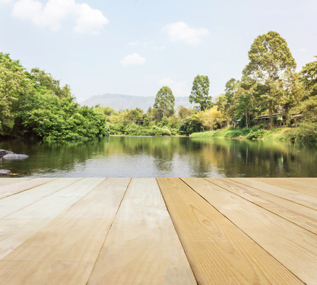 jointed: Blank area or space table top on river or stream view with mountain and sky background, jointed wood table top for putting background