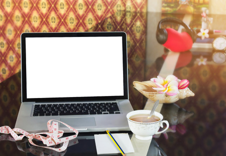 laxative: Blank screen computer, notebook, or laptop on counter with cup of hot tea in background of tape measure blank note paper or memo note and pencil for concept of searching media or data tips for weight loss and diet for health Stock Photo