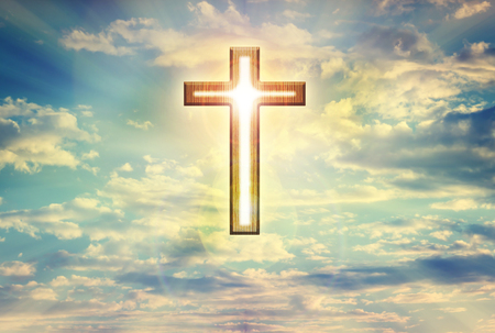 time to shine: God light trough crucifix form on dreamy clouds blue sky, believe, hope ,trust,heaven and God background