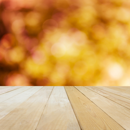 jointed: Blank area or space table top on bokeh orange and yellow spring summer mood nature background, jointed wood table top for putting background Stock Photo