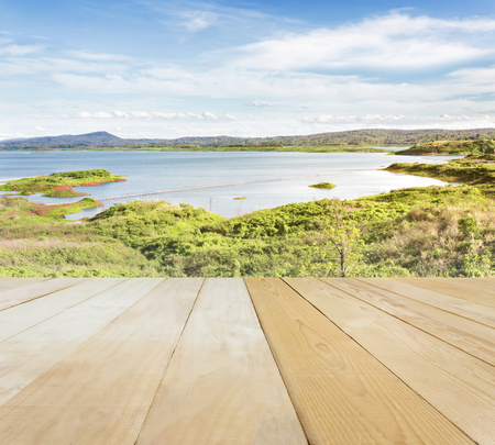 jointed: Blank area or space table top on wide lake or reservoir with puffy clouds blue sky and mountain in spring or summer mood nature background, jointed wood table top for putting background