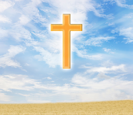 expel: Crucifix or cross on puffy clouds blue sunny day sky with grass field for background
