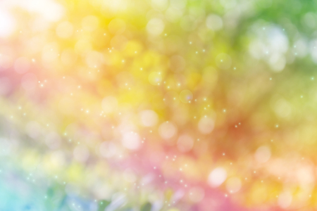 disseminate: Dreamy colourful rainbow colour bokeh and lens flare romantic mood abstract sparkle glitter fancy background