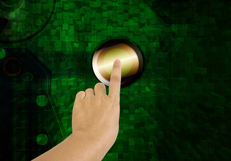 node: Hand and finger press or push big button or node on electronic technolgy green background