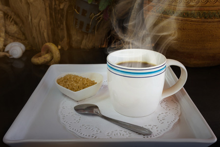 simply: Big white cup of hot black coffee with sugar in still-life colour tone, classic simply black coffee on white tray Stock Photo