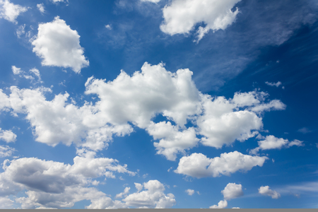 puffy: Densely puffy clouds on fresh cheerful blue sky