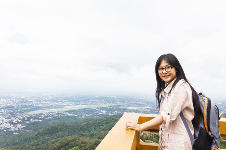 packsack: Smiling Asian girl or women with backpack on highland top city view