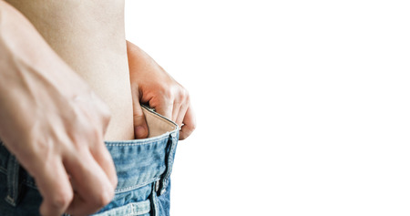 slack: Isolated closeup loose denim jeans trouser at waist, diet girl or women and slender or body changed for beauty and healthy concept Stock Photo