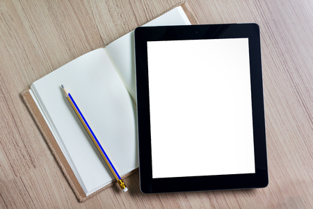 blank tablet: Blank screen tablet on blank page diary with pencil on wooden floor