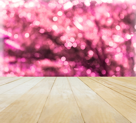 jointed: Jointed wood table top for putting products on Xmas New Year theme pink bokeh background Stock Photo