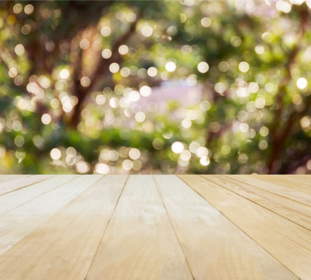 jointed: Jointed wood table top for putting products on Xmas New Year theme green tree bokeh background Stock Photo