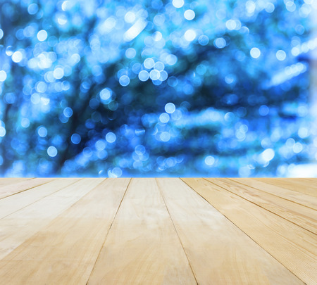 jointed: Jointed wood table top for putting products on Xmas New Year theme blue bokeh background