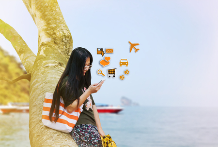Myopia women gaze at mobile phone in relax vacation day at the sea Stock Photo