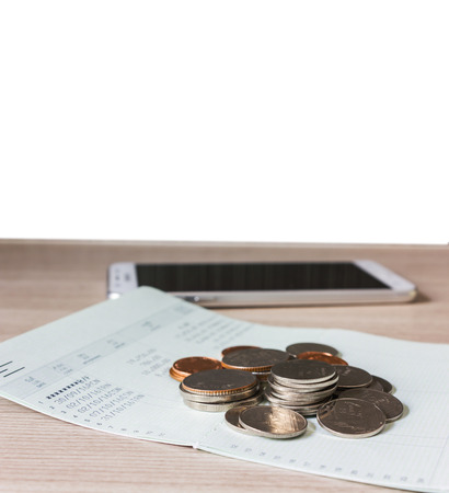 Coins on book bank account for money saving concept and white blank space background