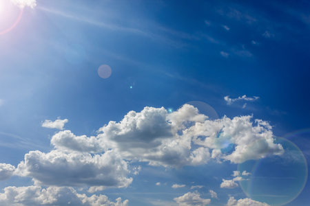 Light blue dreamy heavently sky with lense flare