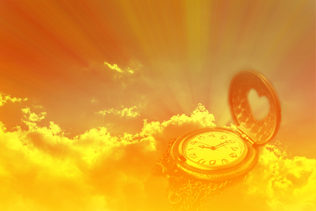 Watch or clock in dreamy sun ray light emerge or spread trought the big dark cound golden sky Stock Photo