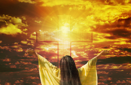 Thank you God, women back or rare view with big crucifix or cross on golden sky