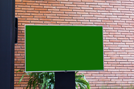 Big empty blank green screen LED television with stand  Standard-Bild