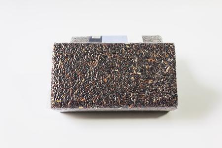 Organic natural riceberry on white background, purple rice