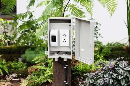 The power outlet in the protection or safety box with stand outside at the garden Standard-Bild