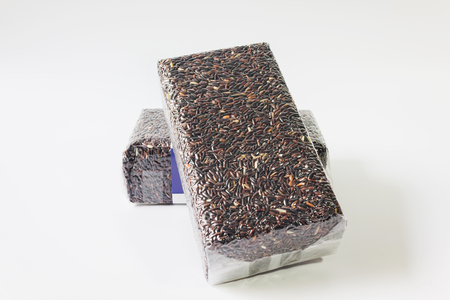Isolate organic natural riceberry on white background, purple rice