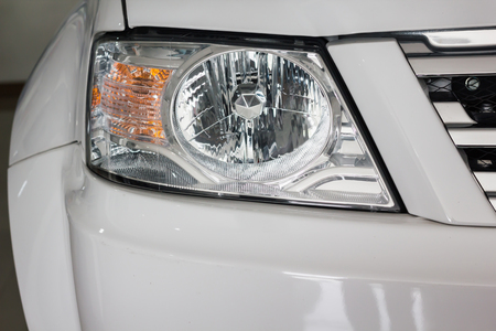 Focused at new headlamp of blond car