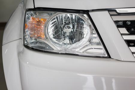 Focused at new headlamp of blond car Standard-Bild - 105108623