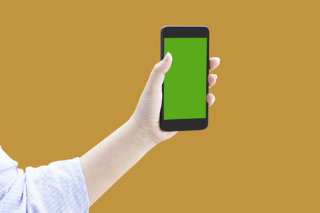 Isolated women hand hold or show or present smart phone or mobile phone or cellphone on orange background